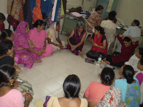 All of our meetings with the women are conducted on the floor.  We sit in a circle and talk.  At the Workshop, 4 things were happening – we were meeting with the Social Action Leaders, Shaily and Lalita were having a meeting with a fabric producer, the design workshop artisans, and Prajakta was having a meeting with the business leaders on profit and loss.