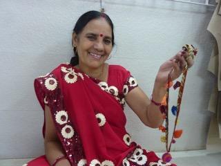 Tara displays a chindi necklace