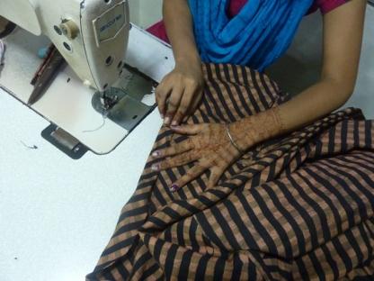 Folding & stitching bottom hem.